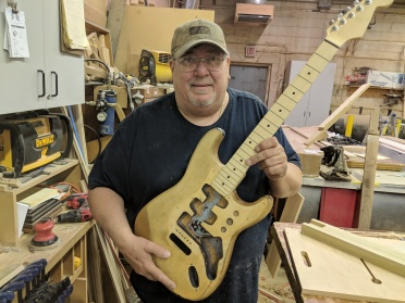 Don posing with guitar